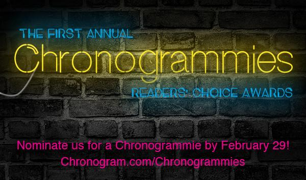 Nominate the L Salon for The Chronogrammies! Neon Sign on a black wall