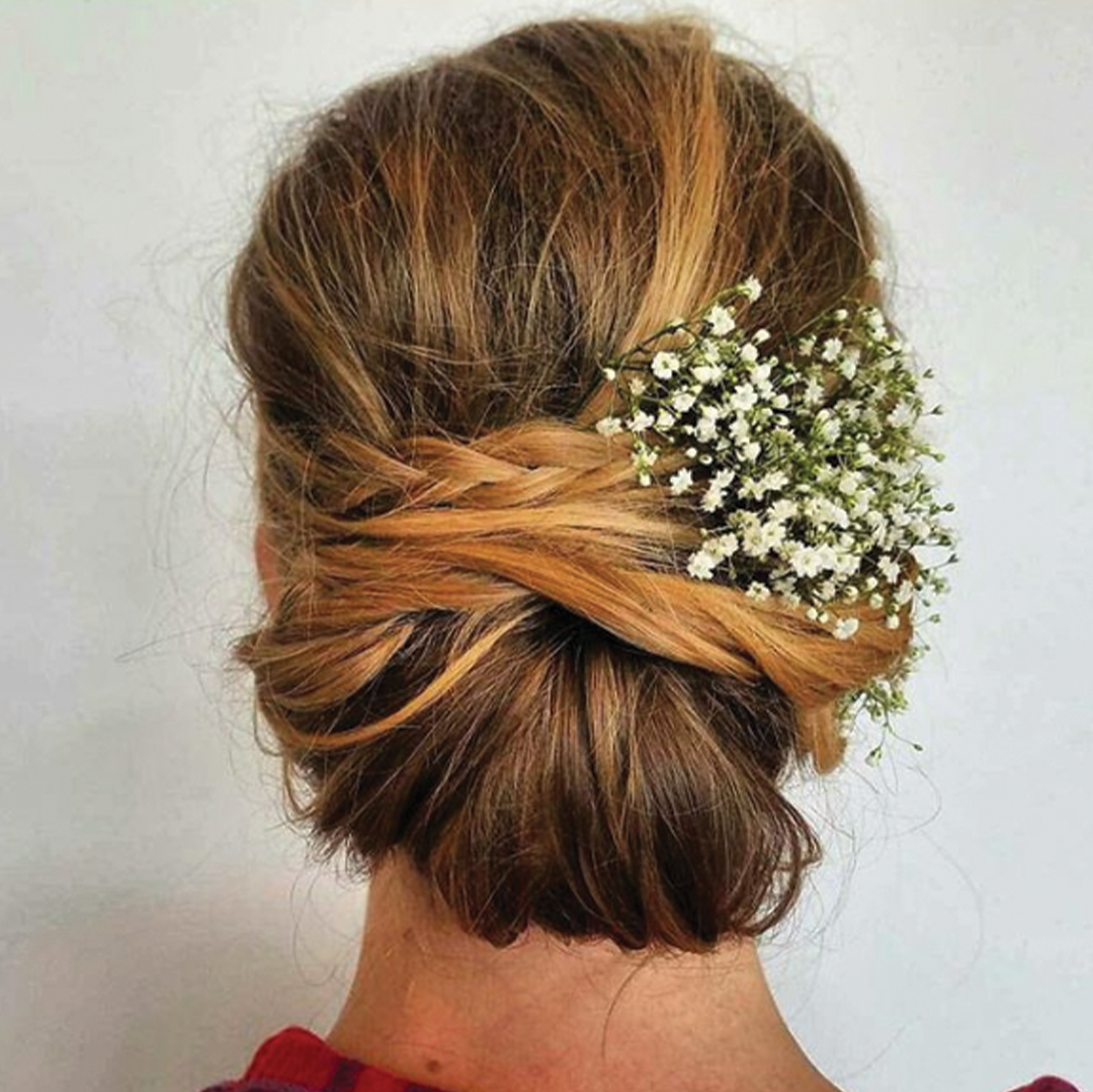 bridal hair, low bun with braids and flowers on the side