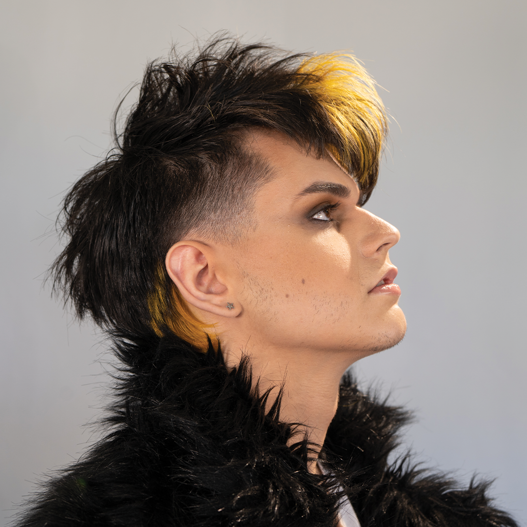 male haircut, black hair with yellow hair in the front and back