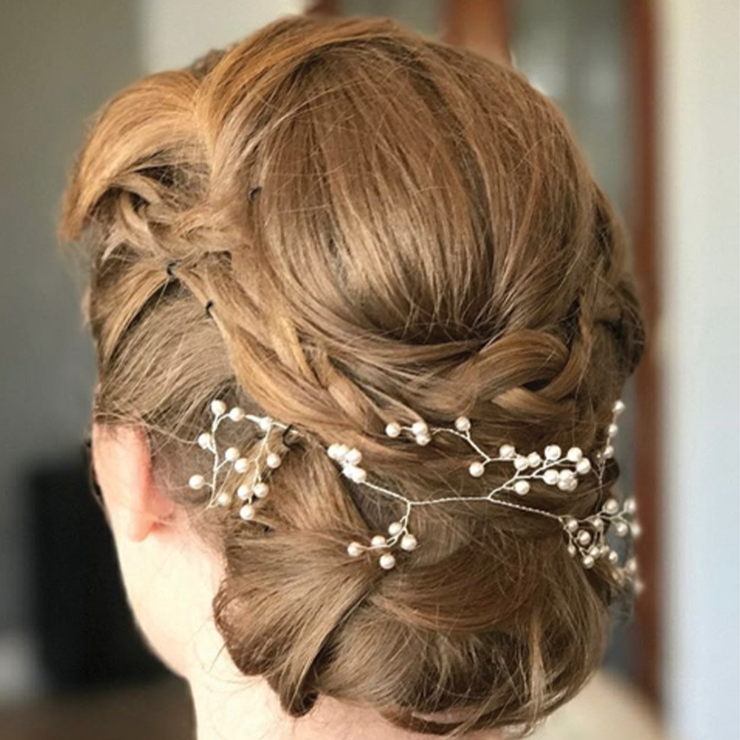 About us gallery, an updo with pearl like branchs in her hair