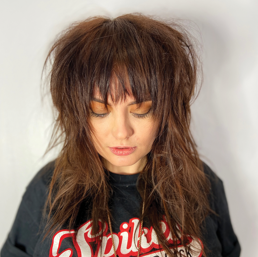 brown hair rough cut with bangs