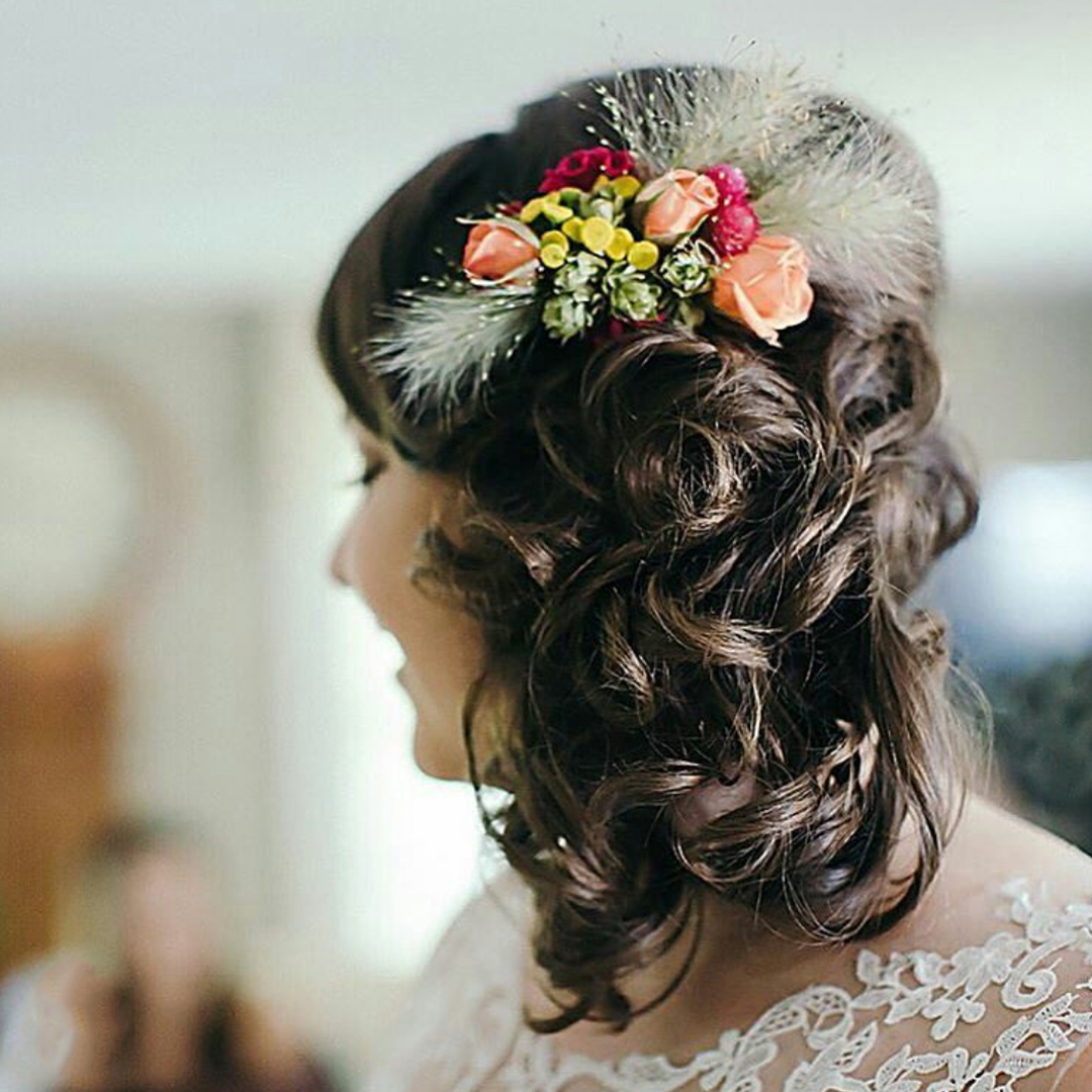 bride with a side hairdo and flowers