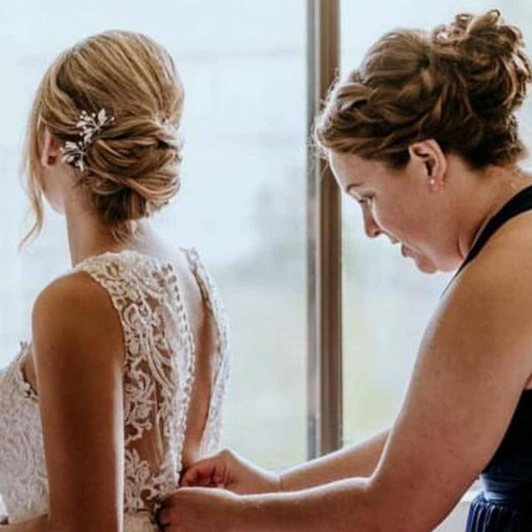 bride with an updo and bridesmaid with a braided updo