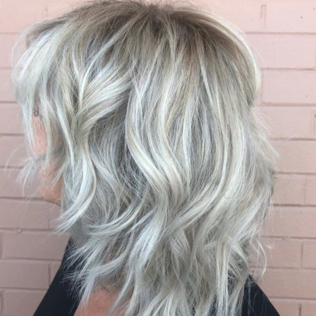 Blonde hair color with a short layered cut