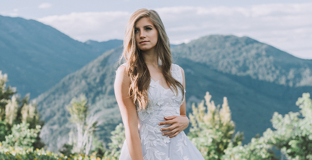 Bride in front of mountains