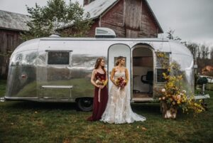 bridal trailer with bride and bridesmaid
